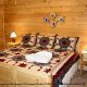Country bedroom in cabin 306 (A Smoky Mountain Dream) , in Pigeon Forge, Tennessee.