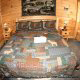 Country bedroom in cabin 308 (The Cozy Bear ) , in Pigeon Forge, Tennessee.