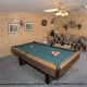 Game room with Pool Table in cabin 308 (The Cozy Bear ) , in Pigeon Forge, Tennessee.