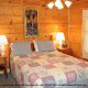 Country bedroom in cabin 309 (Georges) at Eagles Ridge Resort at Pigeon Forge, Tennessee.