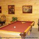 Game room with pool table in cabin 309 (Georges) at Eagles Ridge Resort at Pigeon Forge, Tennessee.