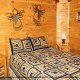 Country bedroom in cabin 312 (Bear Mountain Memories) at Eagles Ridge Resort at Pigeon Forge, Tennessee.