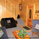 Country den in cabin 312 (Bear Mountain Memories) at Eagles Ridge Resort at Pigeon Forge, Tennessee.