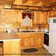 Country kitchen with bar in cabin 312 (Bear Mountain Memories) at Eagles Ridge Resort at Pigeon Forge, Tennessee.