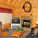 Living room with fireplace in cabin 312 (Bear Mountain Memories) at Eagles Ridge Resort at Pigeon Forge, Tennessee.