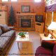Living room with vaulted ceiling and fire place in cabin 314 (Yall Come Back Now Ya Hear) , in Pigeon Forge, Tennessee.