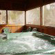 Hot Tub on Deck in Cabin 33 (Ganmas Getaway) at Eagles Ridge Resort at Pigeon Forge, Tennessee.