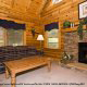 Living Room View with Fire Place of Cabin 36 (Cozy Creek side) at Eagles Ridge Resort at Pigeon Forge, Tennessee.