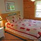 Country bedroom in cabin 41 (Tennessee Mountain Memories) , in Pigeon Forge, Tennessee.