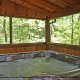 Porch with hot tub in cabin 41 (Tennessee Mountain Memories) , in Pigeon Forge, Tennessee.