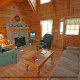 Living room with vaulted ceilings and fireplace in cabin 41 (Tennessee Mountain Memories) , in Pigeon Forge, Tennessee.