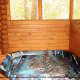 Hot Tub on Deck in Cabin 42 (Three Bears Lodge) at Eagles Ridge Resort at Pigeon Forge, Tennessee.