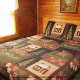 Bedroom with King Size Bed in Cabin 47 (Moody Blue) at Eagles Ridge Resort at Pigeon Forge, Tennessee.