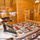 Bedroom View with Colorful Quilt of Cabin 57 (Bear Heaven) at Eagles Ridge Resort at Pigeon Forge, Tennessee.