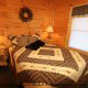 Country Bedroom View of Cabin 6 (On Eagles Wings) at Eagles Ridge Resort at Pigeon Forge, Tennessee.