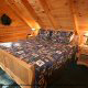 Bedroom with King Size Bed in Cabin 6 (On Eagles Wings) at Eagles Ridge Resort at Pigeon Forge, Tennessee.