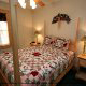 Bedroom with Night Stands in Cabin 6 (On Eagles Wings) at Eagles Ridge Resort at Pigeon Forge, Tennessee.