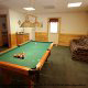 Game Room View with Pool Table in Cabin 6 (On Eagles Wings) at Eagles Ridge Resort at Pigeon Forge, Tennessee.