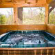 Hot Tub on Deck in Cabin 64 (Heavenly Peace) at Eagles Ridge Resort at Pigeon Forge, Tennessee.