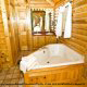 Bathroom View with Jacuzzi of Cabin 70 (Mountain Laurel Hideaway) at Eagles Ridge Resort at Pigeon Forge, Tennessee.