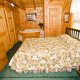 Bedroom with King Size Bed in Cabin 74 (Gerralds Chalet) at Eagles Ridge Resort at Pigeon Forge, Tennessee.