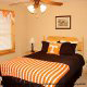 Country bedroom in cabin 813 (Heavenly View) at Eagles Ridge Resort at Pigeon Forge, Tennessee.