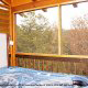 Back porch with hot tub in cabin 813 (Heavenly View) at Eagles Ridge Resort at Pigeon Forge, Tennessee.
