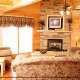 Living room with fireplace in cabin 813 (Heavenly View) at Eagles Ridge Resort at Pigeon Forge, Tennessee.