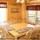 Large dining room in cabin 815 (As Good As it Gets) at Eagles Ridge Resort at Pigeon Forge, Tennessee.