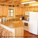 Kitchen with bar in cabin 815 (As Good As it Gets) at Eagles Ridge Resort at Pigeon Forge, Tennessee.