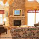 Living room with fireplace in cabin 815 (As Good As it Gets) at Eagles Ridge Resort at Pigeon Forge, Tennessee.