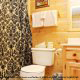 Bathroom View with Shower Curtain in Cabin 816 (Almost Paradise) at Eagles Ridge Resort at Pigeon Forge, Tennessee.