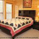 Bedroom with Queen Size Bed in Cabin 816 (Almost Paradise) at Eagles Ridge Resort at Pigeon Forge, Tennessee.