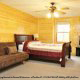 Bedroom with TV Set in Cabin 816 (Almost Paradise) at Eagles Ridge Resort at Pigeon Forge, Tennessee.