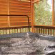 Outdoor hot tub in cabin 819 (mountain majesty) at Eagles Ridge Resort at Pigeon Forge, Tennessee.