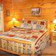 Country bedroom in cabin 821 (Tranquil Times) at Eagles Ridge Resort at Pigeon Forge, Tennessee.