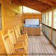 Large front porch with hot tub in cabin 821 (Tranquil Times) at Eagles Ridge Resort at Pigeon Forge, Tennessee.