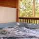 Deck with hot tub in cabin 821 (Tranquil Times) at Eagles Ridge Resort at Pigeon Forge, Tennessee.