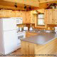 Country kitchen with bar in cabin 821 (Tranquil Times) at Eagles Ridge Resort at Pigeon Forge, Tennessee.