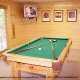 Game room with pool room in cabin 821 (Tranquil Times) at Eagles Ridge Resort at Pigeon Forge, Tennessee.