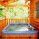 Deck with Hot Tub - Cabin 832 (Lakeside Hideaway) at Eagles Ridge Resort at Pigeon Forge, Tennessee.
