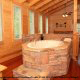 Unique Jacuzzi Design - Cabin 832 (Lakeside Hideaway) at Eagles Ridge Resort at Pigeon Forge, Tennessee.