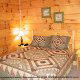 Country bedroom in cabin 845 (Eagle Watch) , in Pigeon Forge, Tennessee.