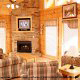 Living room with fireplace in cabin 845 (Eagle Watch) , in Pigeon Forge, Tennessee.