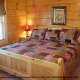 Bedroom with King Size Bed in Cabin 849 (Sweet Escape) at Eagles Ridge Resort at Pigeon Forge, Tennessee.