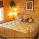 Bedroom with King Size Bed in Cabin 850 (Simply The Best) at Eagles Ridge Resort at Pigeon Forge, Tennessee.