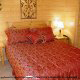 Bedroom with Two Night Stands in Cabin 850 (Simply The Best) at Eagles Ridge Resort at Pigeon Forge, Tennessee.