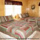 Country bedroom in cabin 853 (Beary Cozy) at Eagles Ridge Resort at Pigeon Forge, Tennessee.