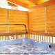 Porch with hot tub in cabin 853 (Beary Cozy) at Eagles Ridge Resort at Pigeon Forge, Tennessee.