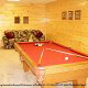 Game room with pool table in cabin 853 (Beary Cozy) at Eagles Ridge Resort at Pigeon Forge, Tennessee.
